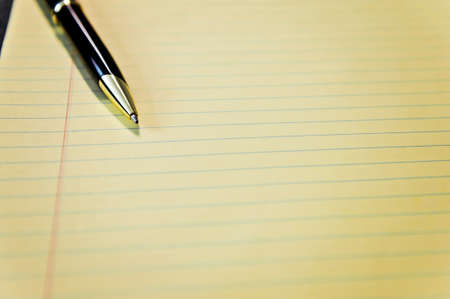 yellow legal pad with pen Stock Photo