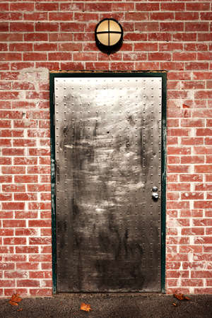 a secure door, like a bank vault, in a brick wall Stock Photo - 18754526