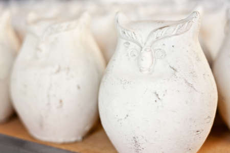 a row of clay owls, homeware or garden decoration photo