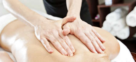 massage in a clinic, wide shot photo