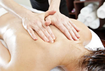 therapeutic massage: massage with oil Stock Photo