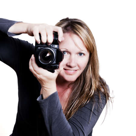 female photographer aiming her camera at you. no brand on camera. photo