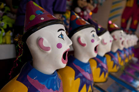 row of clown heads, turning away from camera Stock Photo