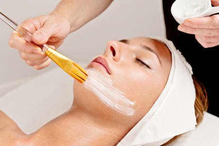 beauty treatment, beautician applying cleanser