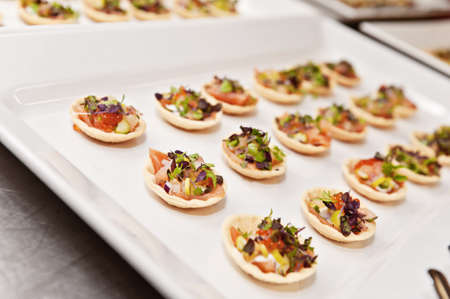 a plate of finger food, typically seen at a function