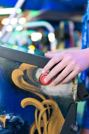 pinball: pinball machine, finger on the button Stock Photo