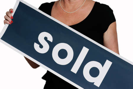 woman holding a sold sign photo
