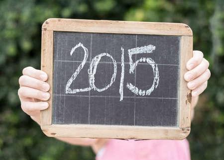 2015 written on vintage slateboard in chalk photo