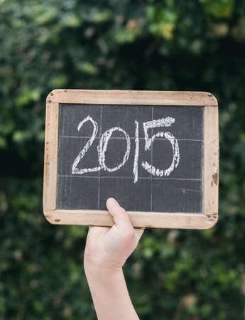 slateboard: 2015 written on vintage slateboard in chalk