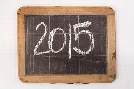 slateboard: 2015 on blackboard on white paper