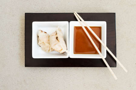 gyoza: asian gyoza dumplings with sauce and chopsticks Stock Photo