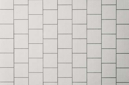 grout: background of a tiled wall, white tiles with black grout Stock Photo