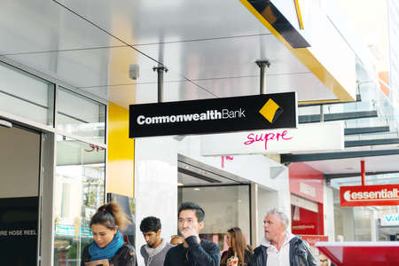 commonwealth: ADELAIDE, SA, AUSTRALIA - May 23, 2015: people walking past a Commonwealth Bank.