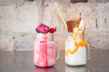 bad banana: cherry chocolate slice and banana bread milkshake, there is fruit in there, is it so bad Stock Photo