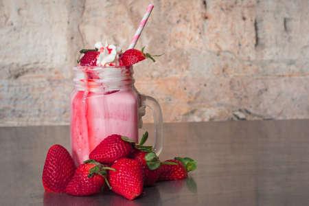 milkshake: amazing strawberry milkshake with whipped cream Stock Photo
