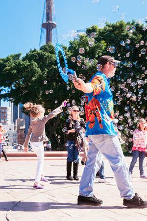 entertainers: street entertainer in Hyde Park, Sydney, Australia, April 2012 Editorial