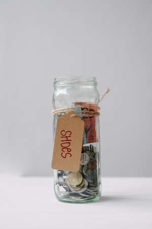 savings goals: money jar with australian money and the note shoes