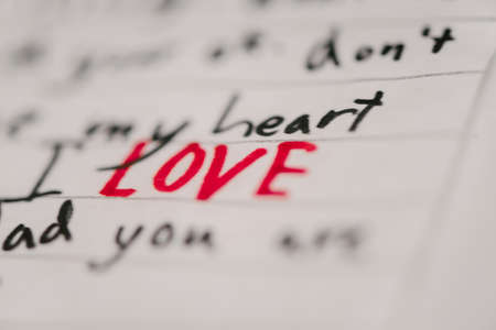 bold: hand written note with the word love in bold, red letters