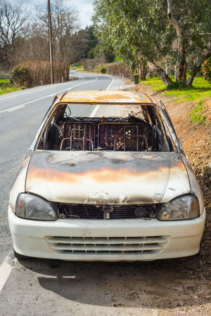 burnt out: burnt out stolen car abandonded on the roadside Stock Photo