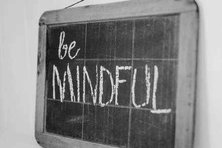 mindful: blackboard with the message be mindful Stock Photo
