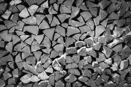 blackwhite: Black-white background of dry chopped firewood Stock Photo