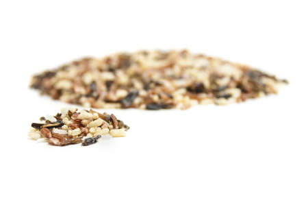 A small pile of wild rice in front of anoth larger pile. Stock Photo - 8955910