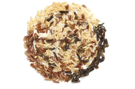 Three types of rice in a circle filled with wild rice. photo
