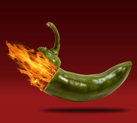 peppered: Stem of horizontal  jalapeno opening with fire coming out.