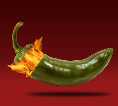 peppery: Conceptual photograph of a jalapeno exploding with fire