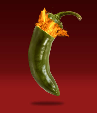 Conceptual photograph of a jalapeno exploding with fire photo