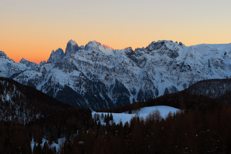 San Martino Pale covered with snow at sunset, San Pellegrino pass, Dolomites