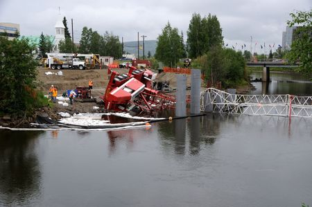 oil and gas industry: Fairbanks, Alaska - June 29, 2010 : Crane Constructing Highway Bridge Collapses