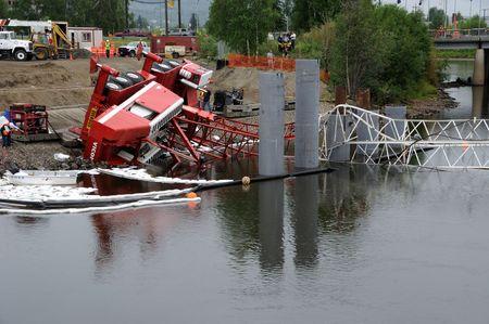 cranes: Fairbanks, Alaska - June 29, 2010 : Crane Constructing Highway Bridge Collapses