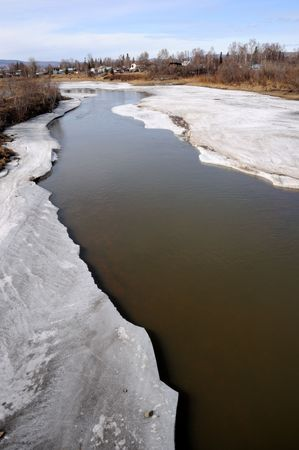 thawing: Arctic River thawing during Spring Breakup  Stock Photo