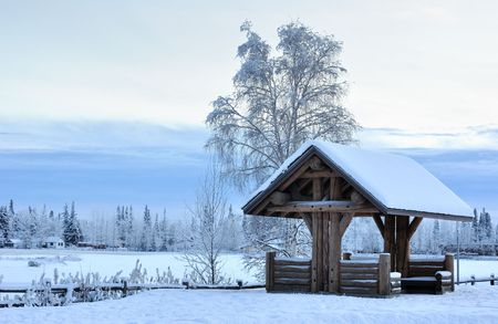 Log Pavilion in Alaska during the Winter  photo