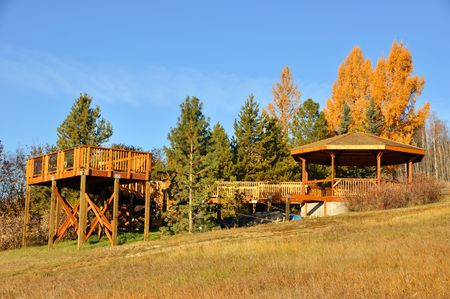 Elevated Deck and Gazebo amongst the Trees on a Fall Morning  photo