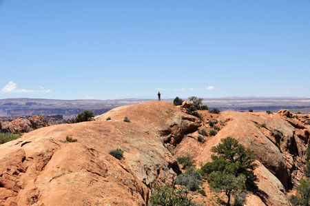 upheaval: Hiker at Edge of Upheaval Dome - Canyonlands Stock Photo