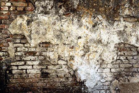 dilapidated: Dilapidated brick wall Stock Photo