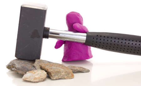 modelling clay: Modelling clay figure with a sledge  Stock Photo