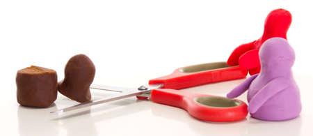 modelling clay: Modelling clay figures with scissors Stock Photo