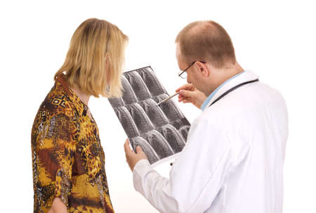 Medical doctor examining a patient photo