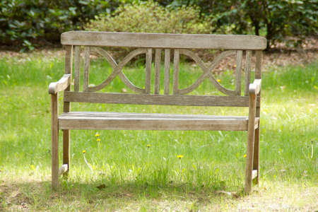 reclusion: Lonely bench standing in a park Stock Photo