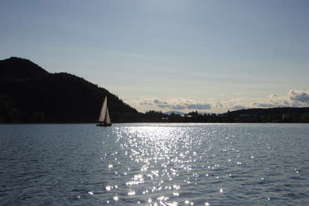 A sailboat gliding on the lake photo