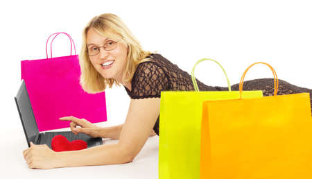 Attractive woman shopping over the internet Stock Photo - 15176180