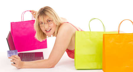 Attractive woman shopping over the internet photo