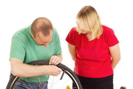 A mechanic repairs the wheel of a bicycle Stock Photo - 15266298