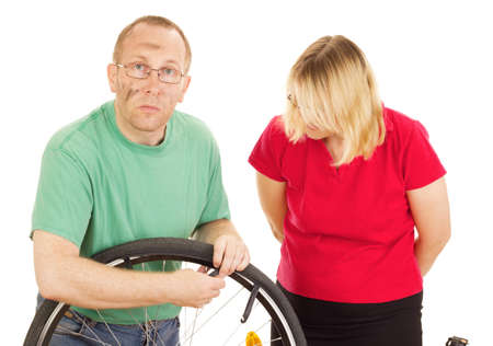 avocation: A mechanic repairs the wheel of a bicycle