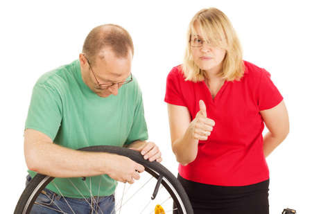 scroller: A mechanic repairs the wheel of a bicycle