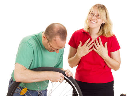 A mechanic repairs the wheel of a bicycle Stock Photo - 15266299