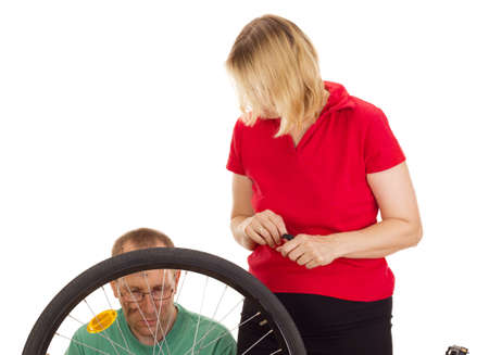 A mechanic repairs the wheel of a bicycle Stock Photo - 15266293